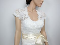 Ivory Front open Alencon Lace bolero jacket and add a plain satin ribbon sash. $99.99, via Etsy.