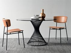 Fifties chairs (tanned leather) and Vortex table (glass) by Calligaris - check our catalogues and create your own combo