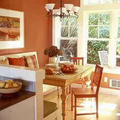 A Fresh Coat of Paint...  Wall color is the primary way to set the mood of a space. Pick a bold fall shade, such as this room's deep orange, and play it up with harvest-inspired accents. The natural lighting through the bay window enhances this kitchen's sunny atmosphere.