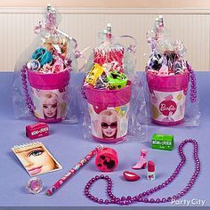These Barbie party cups filled with fab favors  are the perfectly posh way to say goodbye! Click for more stylish Barbie party ideas!