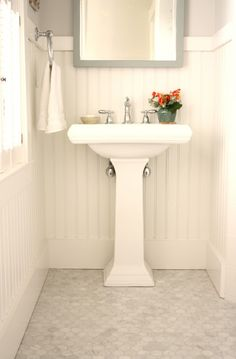 Love the beadboard and the tile. Would work withthe tile in the shower/tub and lighten up the whole room!!!