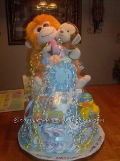 Coolest Monkey Diaper Cake... This website is the Pinterest of diaper cake ideas