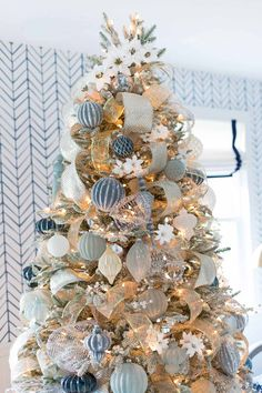 elegant christmas tree Faux white poinsettias spiral up the top of this gorgeous tree instead of a tree topper! Blue Christmas Decor, Elegant Christmas Trees, Christmas Tree Themes, Xmas Decorations, Xmas Tree, Christmas Home, Christmas Wreaths, Merry Christmas, Tree Tree
