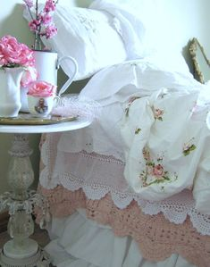 Vintage rosy sheets, crochet lace and a beautiful bedside table.