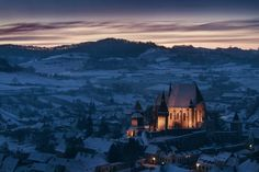 Fortified church of Biertan at blue hour Photo by Raul Jichici — National Geographic Your Shot