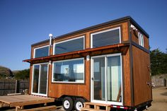Molecule Tiny Homes: Surf Shack. Really like the layout and high ceilings!
