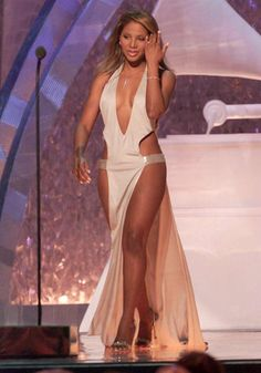Toni Braxton at the 2001 Grammy Awards in her legendary Richard Tyler white satin dress. It has gone down in history for being the most revealing and sexiest dresses that have been made.