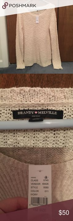 Brandy Melville sweater NWT Brandy Melville sweater, new with tags. Cream / off-white color. Ships within 24 hours Brandy Melville Sweaters