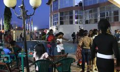 Nov 6th 2014 - Ebola in Guinea: reggae plays on in Gueckedou as clubbers try to relax. Amid the epidemic, young people are carrying on dancing at the Fatou Rose hotel, putting Red Cross health advice to one side and trusting in chlorinated water.