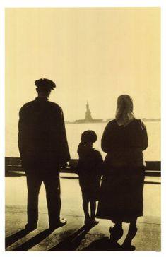 Immigrant Family Looking At Statue Of Liberty From Ellis Island. An inspiring article about women in the home.