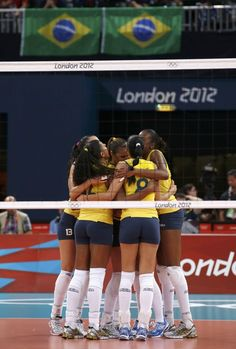 Brazilian women's volleyball team take gold - Brazil's players celebrate a point against the U.S. during their women's gold medal volleyball match at Earls Court during the London 2012 Olympic Games August 11, 2012. REUTERS/Marcelo Del Pozo