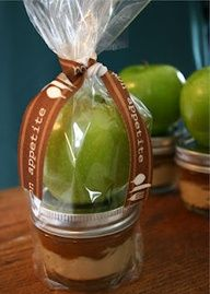 small, squatty canning jars filled  with some type of apple dip.  Then tie a crispy fresh green apple to the top - added a sweet ribbon - and it's now ready to be given as a sweet gift. (caramels)