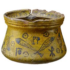 A ceramic vessel made in Syria between 800 and 1000 decorated with Christian symbols, including fish (an ancient symbol of Christ) and the chi-rho (or monogram of Christ). (Museum for Kunst und Gewerbe, Hamburg, Germany)