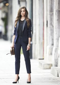 Bring an edgy sophistication to the office by wearing this gorgeous navy blue suit!