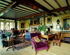 The drawing room has been designed in traditional Scottish style with armchairs and sofas upholstered in tweed and velvet accessorised with tartan throws and cushions. Glenfeshie Lodge in Scotland ~ Ward Denton & Christopher Gardner