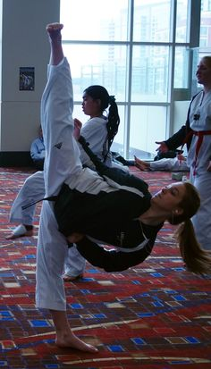 Vertical side kick.  Kempo Karate inspiration!  I think she has been training for a while!