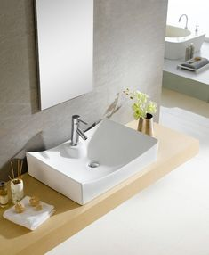 Bring added elegance to your bathroom with this Fine Fixtures modern vessel sink. Constructed of durable and stain resistant vitreous china, this white sink features sleek, deep sides and a modern design. Bathroom Tub Shower, Wall Mounted Bathroom Sinks, Tub Shower Combo, Bathroom Sink Faucets, Bathroom Fixtures, Above Counter Bathroom Sink, Brass Bathroom, Master Shower, Lavatory Faucet