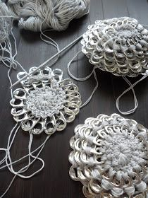 A crochet flower purse, made from little pop tabs from soda. What do you do with these little pop tabs after drinking all the soda and beer? You can make beutiful crochet pop tab projects, as … Read more. Soda Tab Crafts, Can Tab Crafts, Crochet Crafts, Yarn Crafts, Crochet Projects, Crochet Stitches, Knit Crochet, Crochet Patterns, Crochet Handbags