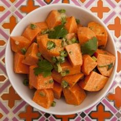 Sweet Potato Salad - I've always preferred my potato salads made with vinaigrette instead of mayonnaise.  This delicious tropical tasting salad makes for a great change from salads made with white potatoes. It is also a great way to keep nutrient rich sweet potatoes in your diet throughout the whole year. They're good on a July 4th picnic as well as on the Thanksgiving table.