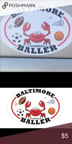 """BALTIMORE CRAB CAR MAGNET A sports inspired oval MARYLAND CRAB Car magnet.  The magnet reads """"BALTIMORE BALLER"""". The happy crab is holding a lacrosse stick and catching a ball. The crab is surrounded by a soccer ball, football, baseball and basketball. Other"""