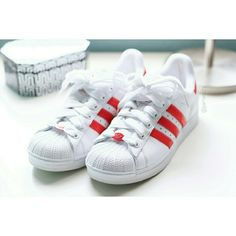 """Adidas   """"Superstar II """" Sneakers Classic Adidas Originals """"Superstar II"""" sneaker in white/red. Shell toe + rare reflective/gel red stripes + reflective/gel red heel upper (see photos). Older style, but in excellent, like-new condition. Very minor rubbing from tongue logo on laces. White insoles still clean, white outsoles are clean and not worn down. No yellowing. Well taken care of. Authentic, but no longer have box. Women's US size 8, UK size 6.5. PRICE IS FIRM. NOT TAKING OFFERS. NO…"""