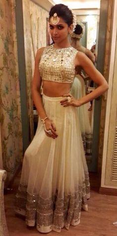 Deepika wearing a Arpita Mehta mirror work crop top and lehenga for one of her film promotion.
