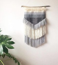 Beautiful and unique gray textured weaving by Weaverella on Etsy. Find more hand neutral wall hangings and weavings in this collection of weavings and wall hangings on the blog, Objectifeyed.