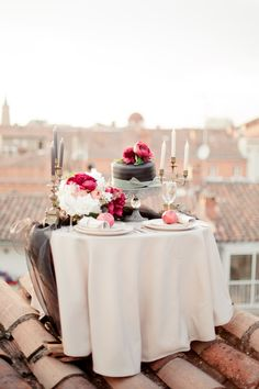 Elegant rooftop table-for-two: http://www.stylemepretty.com/destination-weddings/2015/08/14/romantic-rooftop-engagement-session-in-toulouse-france/ | Photography: Elena Fleutiaux - http://www.photographiemariage.info/#!/HOME