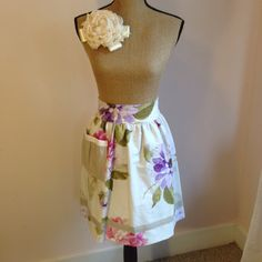 Upcycled Vintage Fabric Half Apron - Cream with Purple and Pink Floral Print and Natural Trim and Pocket.  Lined with Natural Colored Fabric by UppityStuff on Etsy https://www.etsy.com/listing/217979705/upcycled-vintage-fabric-half-apron-cream