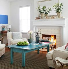 Clean white interiors are a great backdrop for a colorful focal point in a room. Here it's the distressed blue Coffee Table. To make pops of color stand out ...