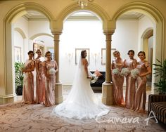 Beautiful photo of the bride with all of her bridesmaids.