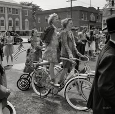"May 1942. ""Southington, Connecticut. Schoolchildren staging a patriotic demonstration."" Which includes Synchronized Stationary Bikes. Photo by Fenno Jacobs for the Office of War Information. Prints from $15."