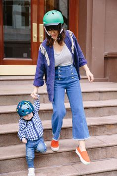 Safety first people! Naomi Davis killin' it again with this indigo outfit. High waisted sailor jeans, blue fringe jacket and cute little baby boy to match.