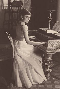 Audrey playing piano elegantly