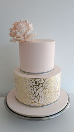 peony flower and petal design over the edible gold leaf - via The Cake Company