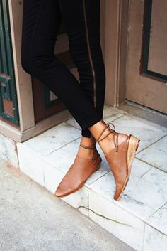 Super soft slip-on leather mules with a stacked wedge a slightly pointed toe and adjustable ankle ties. Padded footbed for extra comfort. $128.00 by Free People