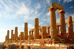 Valley of the Temples, Agrigento    Sicily's most celebrated archaeological site preserves a proud group of temples from the fifth century BC, as well as houses, streets, and tombs -- all set on a ridge amid olive and almond trees and overlooking the sea.    Photo Caption: Agrigento. Photo by gmsanders/Frommers.com Communitiy