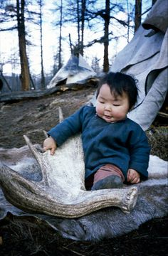 Tsaatan (Dukha) Reindeer Child, Mongolia. Tsaatan (reindeer people) have survived for thousands of years inhabiting the remotest subartic taiga, moving between 5 and 10 times a year. Presently, only 44 families (200-400 people) remain, their existence threatened by the dwindling number of their domesticated reindeer. (V)