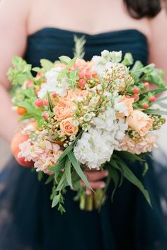 Summer wedding bouquet idea - peach + white floral bouquet with berries and greenery {Amelia Lawrence Weddings}