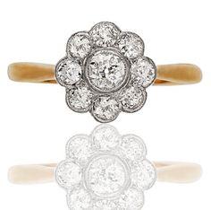 Original 1920s Diamond ring. Pave setting daisy.