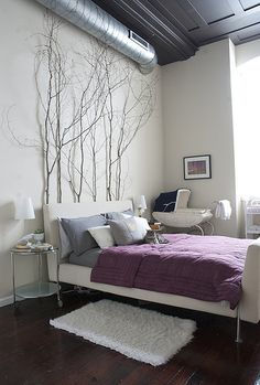 love this loft apartment bedroom...especially those tree branches!