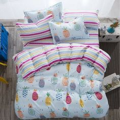 Striped and pineapple print bedding set is a mix of cherry colours perfect for any kid's room.   The bedding set comes with a bed sheet, duvet cover and 1 or 2 pillow covers. The bedding set comes in four sizes Twin, full, queen and king.  #girls #bedroom #nuurdesignsart #duvetcover