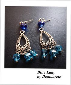 Chandelier earrings made with crystals in shades of blue