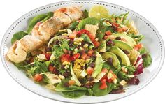 West of Cayman Salad - Organic Mixed Greens, Black Beans, Grilled Corn, Avocado, Pico de Gallo & Tortilla Chips + Fish & Shrimp Skewers from Pasta Salad, Cobb Salad, Shrimp Skewers, Tortilla Chips, Black Beans, Avocado, Salads, Organic, Fish
