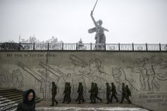 HIGH ALERT: Soldiers walked near a statue in Volgograd, Russia, Tuesday. Police detained dozens of people on Tuesday in sweeps through the Russian city after two deadly terrorist attacks in less than 24 hours. (Sergei Karpov/Reuters)