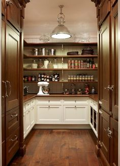 U shaped white and brown cottage kitchen pantry is lit by a country industrial pendant hung over dark stained rustic wood floors accenting facing dark Kitchen Butlers Pantry, Pantry Laundry Room, Kitchen Pantry Design, Dark Kitchen Cabinets, Rustic Cabinets, Butler Pantry, New Kitchen, White Cabinets, Kitchen Wood