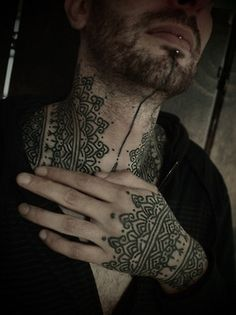 Guy le tattooer hand and neck tattoo. His tattoos seem to be henna inspired. http://guyletatooer.com