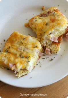 1 can crescent rolls 8 oz. thin sliced Ham, diced 6 eggs 1/2 c milk 1/2 t pepper 2 c shredded Cheese Unroll dough in 13×9 press to cover bottom. Layer ham, whisked eggs, milk, pepper. Top with cheeses. 350 25 min til set.