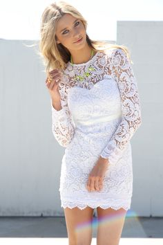 short white wedding dress with long sleeves, hair down