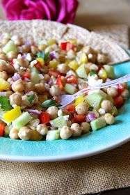 ValSoCal: Healthy Garbonzo Bean Salad. Made with garbanzo beans, red and yellow bell pepper, cucumber, feta cheese, fresh parsley, lemon and lime juice and red wine vinegar.